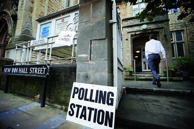 The Oxford Times: Voters arrive at Wesley Memorial Church polling station in Oxford city centre.     Picture: OX67321 Damian Halliwell