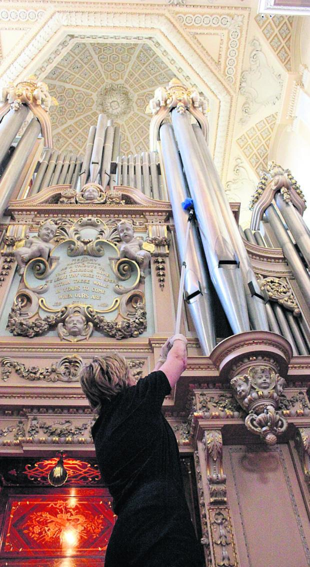 The Oxford Times: Blenheim Palace's conservation cleaner, Christina Dittmers, at work on the giant pipe organ
