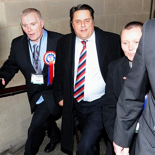 BNP leader Nick Griffin (centre) arrives at the European Parliamentary elections count at Manchester Town Hall