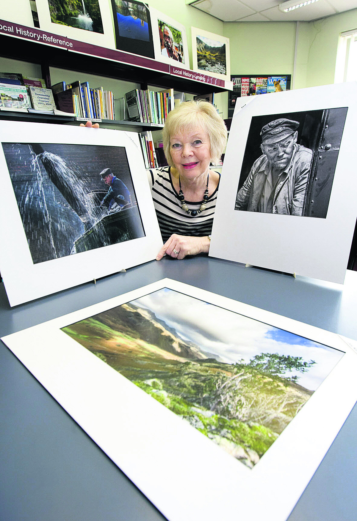 Joy Rawlins, who won the Kidlington Camera Club photography competition, with some of her pictures on show in Kidlington Library		                Picture: OX67354 Antony Moore