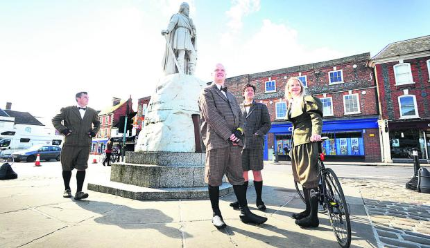 Spencer Pettit, Richard Satterwaite, Dylan Griffiths and Kimberley Keay by King Alfred's statue in Wantage market square