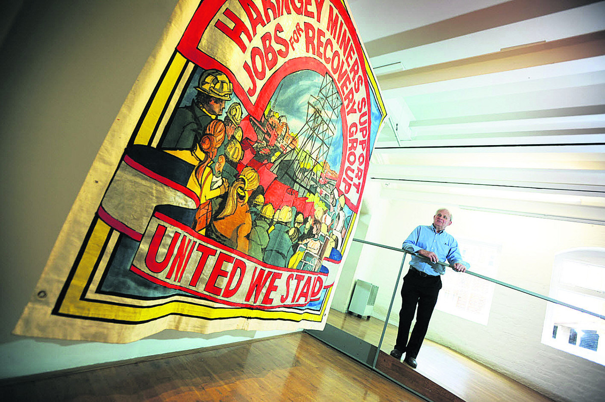 Ed Hall with a banner he made for the Haringey Miners' Support Group in 1984