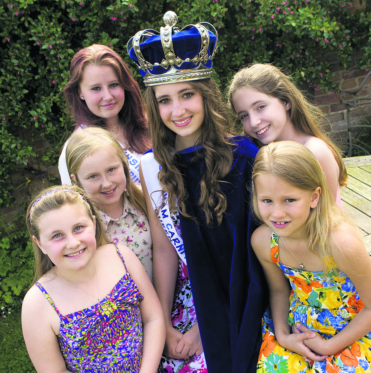 Carnival Queen Rebecca Singleton surrounded by, clockwise from bottom left, Laura Batts, Lucy Bayliss, Deputy Queen Hollie Tuckey, Cordelia Singleton and Brooke Patterson