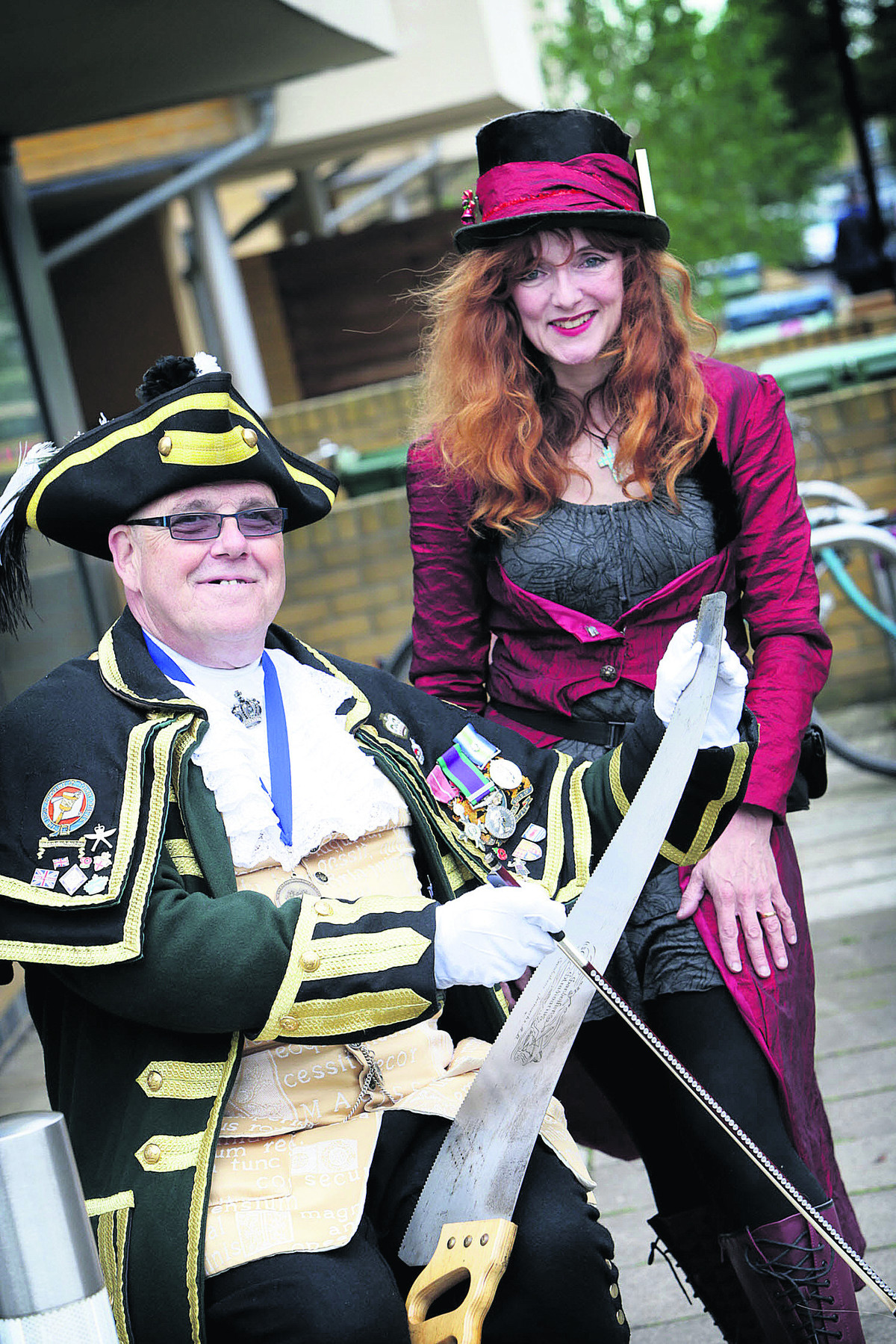 Town Crier, Anthony Church is taught to play the musical saw by Caroline Watsham      Picture: OX67503 Damian Halliwell