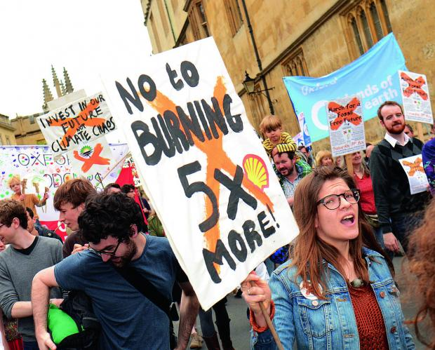The march through Oxford city centre to protest about the use of fossil fuels and call on county firms to stop investing in fossil fuel companies