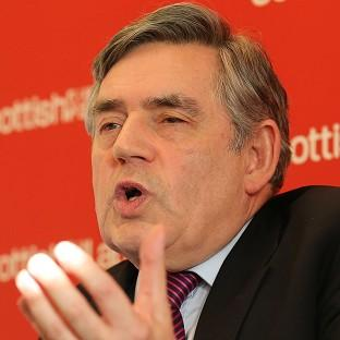 Former prime minister Gordon Brown has attacked the UK Government's handling of the currency debate over Scottish independence