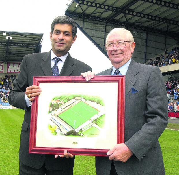 Jack Casley (right) receives a framed picture of United's former Manor Ground from the then United chairman Firoz Kassam  to mark his 42 years' service to the club