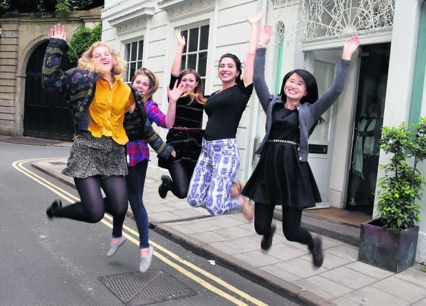 GREAT NEWS: From left, Madeleine Ellis-Peterson, Polly Streather, Lucy Long, Tutku Bektas and Qingling Kong celebrate outside the Oxford Hub offices in Turl Street
