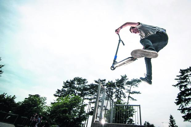 The Oxford Times: Robert Tennant, 15, shows off some scooter skills at the police family fun day at Garth Park, Bicester