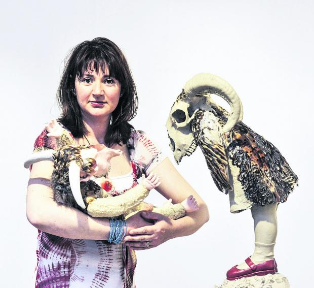 The Oxford Times: Organiser Dr Melissa Westbrook, pictured with two of the exhibits. Picture: OX67581 Mark Hemsworth
