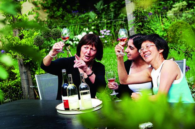 The Oxford Times: Reporter Annabal Bagdi, centre, is given advice on wine tasting ahead of the English Wine Festival, at Bothy Vineyard with, left, Denise Santilli from the Thames and Chilterns Vineyards Association and, right, Sian Liwicki