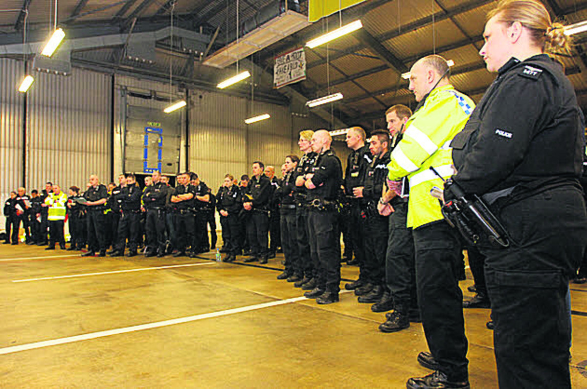 Police prepare to go out on the Operation Bullfinch raids in 2012