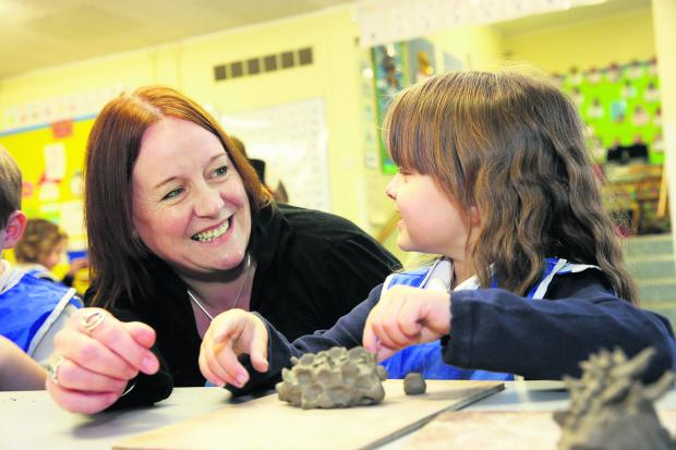 The Oxford Times: Tower Hill Primary School headteacher Tracey Smith with youngster Kymberly Bowles