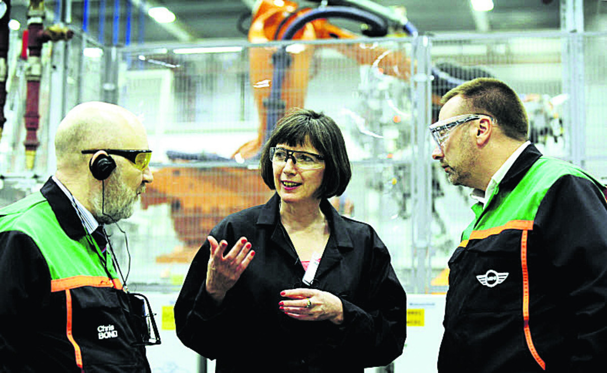 Frances O'Grady with Chris Bond, left, and Bob Shankley in the Body in White building at the Mini factory