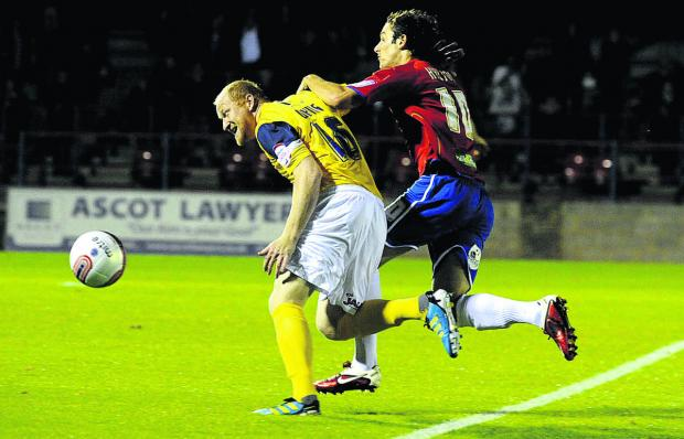 The Oxford Times: Danny Hylton, seen battling for the ball with Oxford United's Andy Whing while playing for Aldershot Town in a Johnstone's Paint Trophy tie three years ago, can't wait to link up with his new teammates