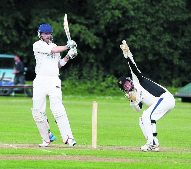 Joe White brings up his 50 as Cumnor wicket-keeper Chris Mitty is unable to stop the boundary