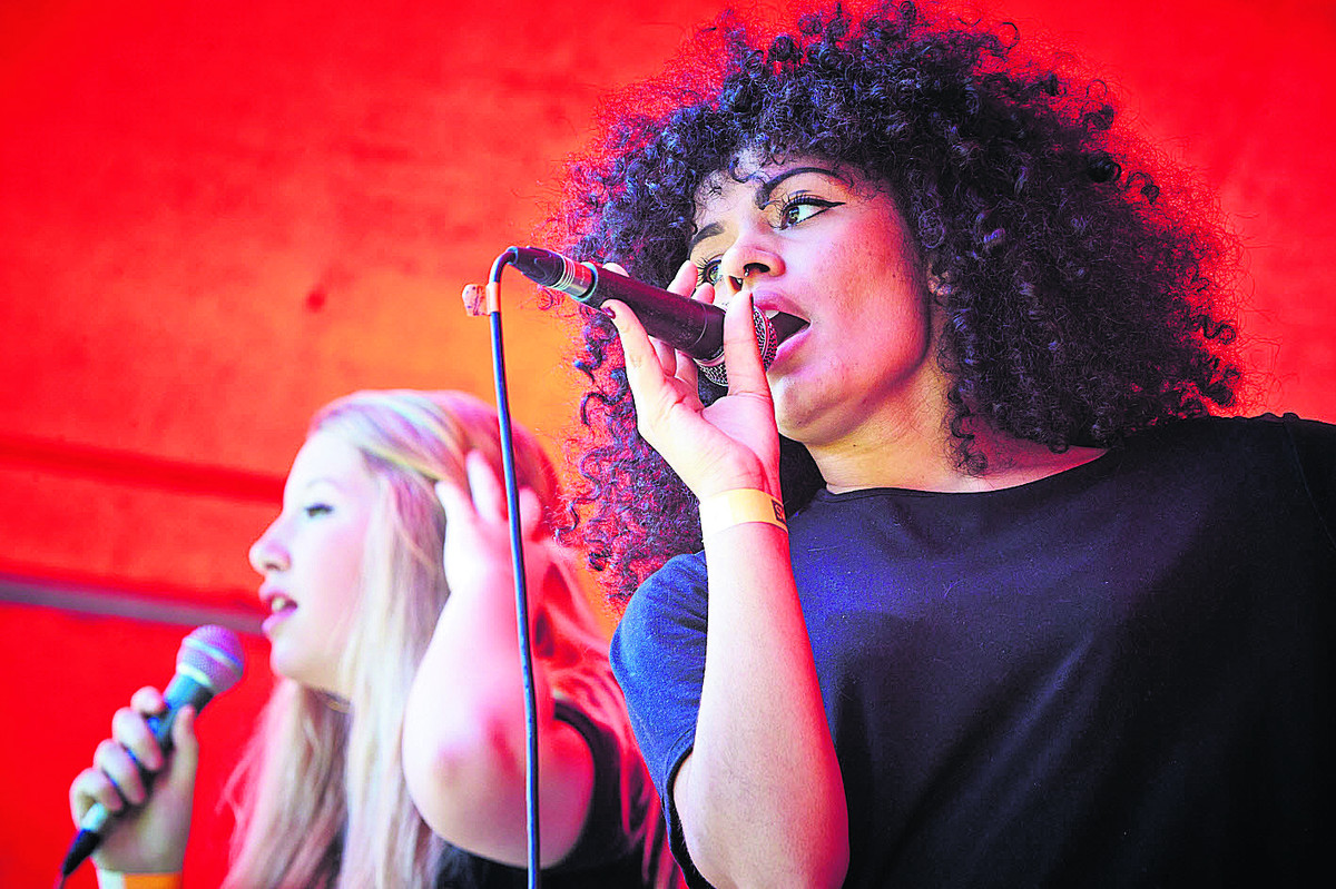 Nina Reiber-Hodgson, left, and Ebony Keisha, from band Nina Jade, who performed at Rock in the Park. Picture: OX67700 Cliff Hide