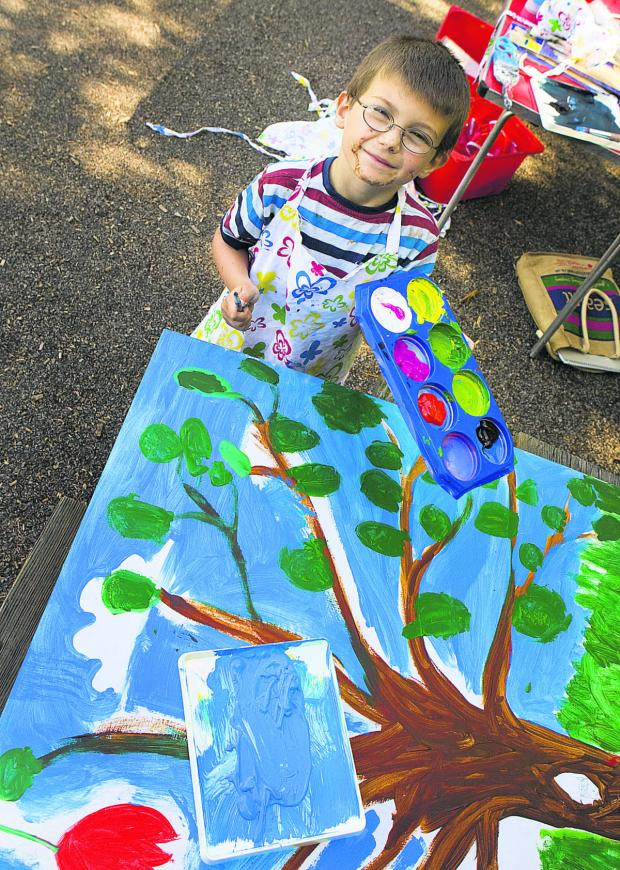 The Oxford Times: Eight-year-old Jerrid Gamage works on the mural. Inset: Artist Lizzy McBain with Bella Skaer, six