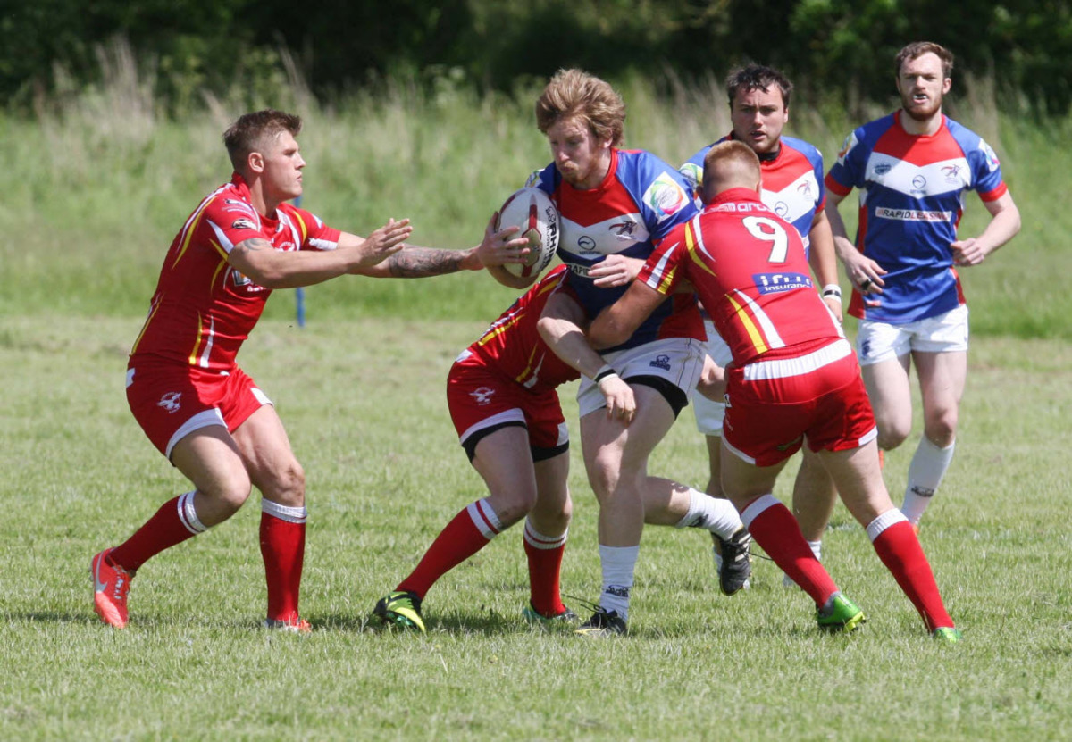 Oxford Cavaliers players Luke Evans attacks during their 44-20 home def