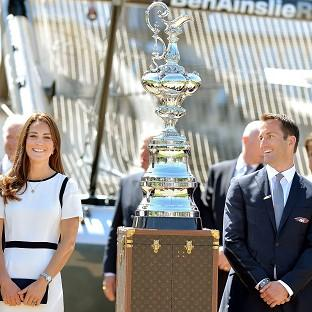 The Oxford Times: The Duchess of Cambridge with Sir Ben Ainslie in front of the America's Cup during a visit to the National Maritime Museum, London