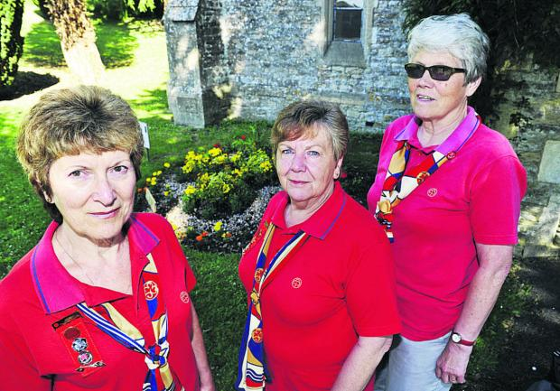 From left, Guides' members Lyn Goodall, Denise Parrott and Margaret Fleetwood at Tower Hill cemetery where shrubs have been stolen from memorial to those who fell in the First World War   	               Picture: OX6