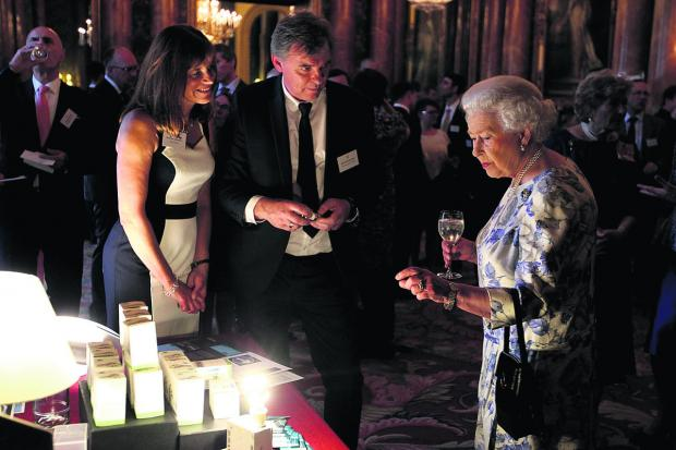 The Oxford Times: Her Majesty asks Zeta managing director Philip Shadbolt and his wife Dawn whether the firm's energy-efficient lightbulbs would work in Buckingham Palace's ornate chandeliers