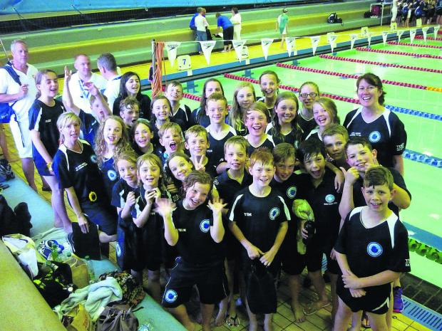 The Bicester Blue Fins squad celebrate their runners-up place in the Milton Keynes & District League Gala
