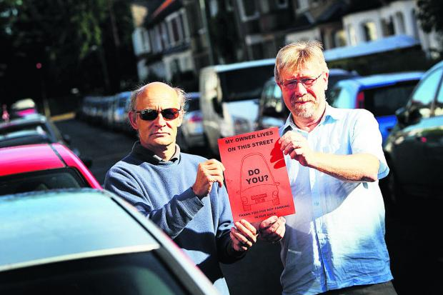 Resident Pete Cranston, left, with Christopher Terry, co-chairman of Iffley Fields Residents' Association parking action group