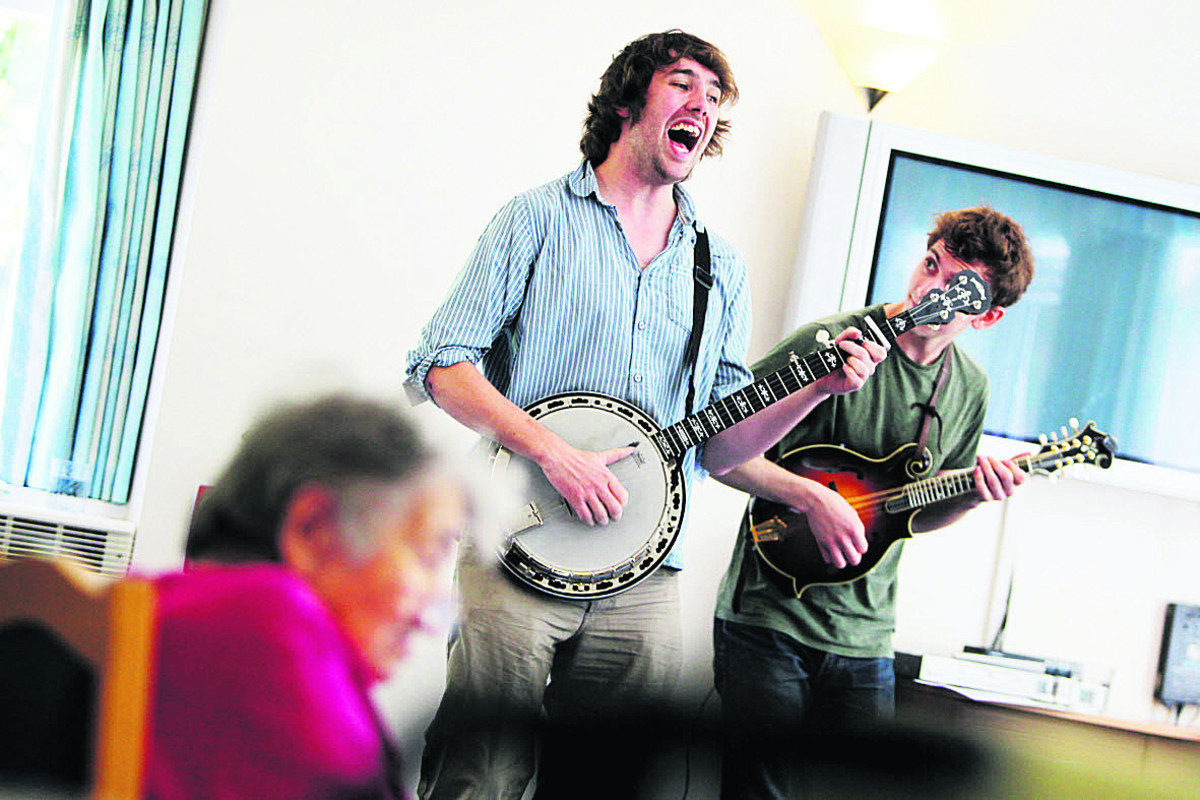 Specially-trained Live Music Now musicians Dan Walsh, left, and Nic Zuppardi, of The Absentees, are playing interactive concerts at the Longlands Care Home to residents as part of a 10-week study into dementia to gauge reactions to the live music