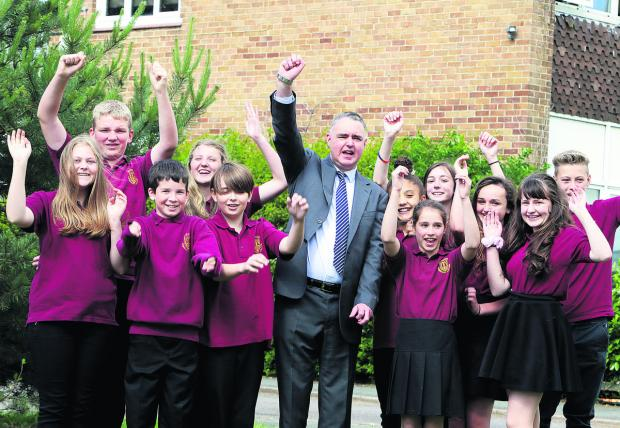 Bicester Community College headteacher Tony Rushworth celebrate the news of their good Ofsted report