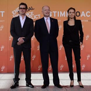 The Oxford Times: Foreign Secretary William Hague (centre), Brad Pitt and Angelina Jolie arrive at the End Sexual Violence in Conflict Summit at the Excel centre in east London.