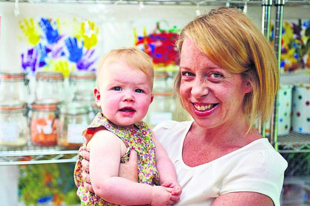 The Oxford Times: Julie Cooper with one-year-old daughter Isa