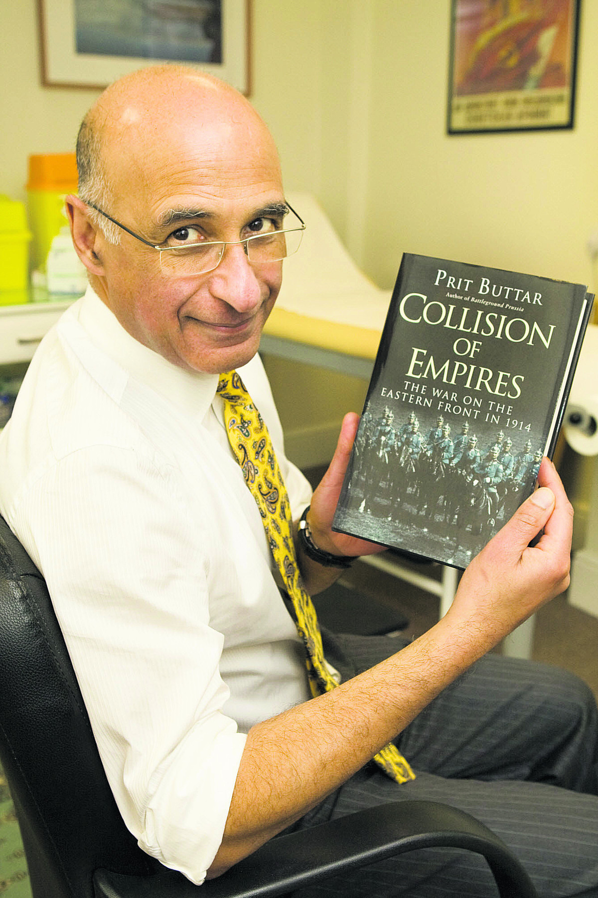 Dr Prit Buttar with a copy of his new book