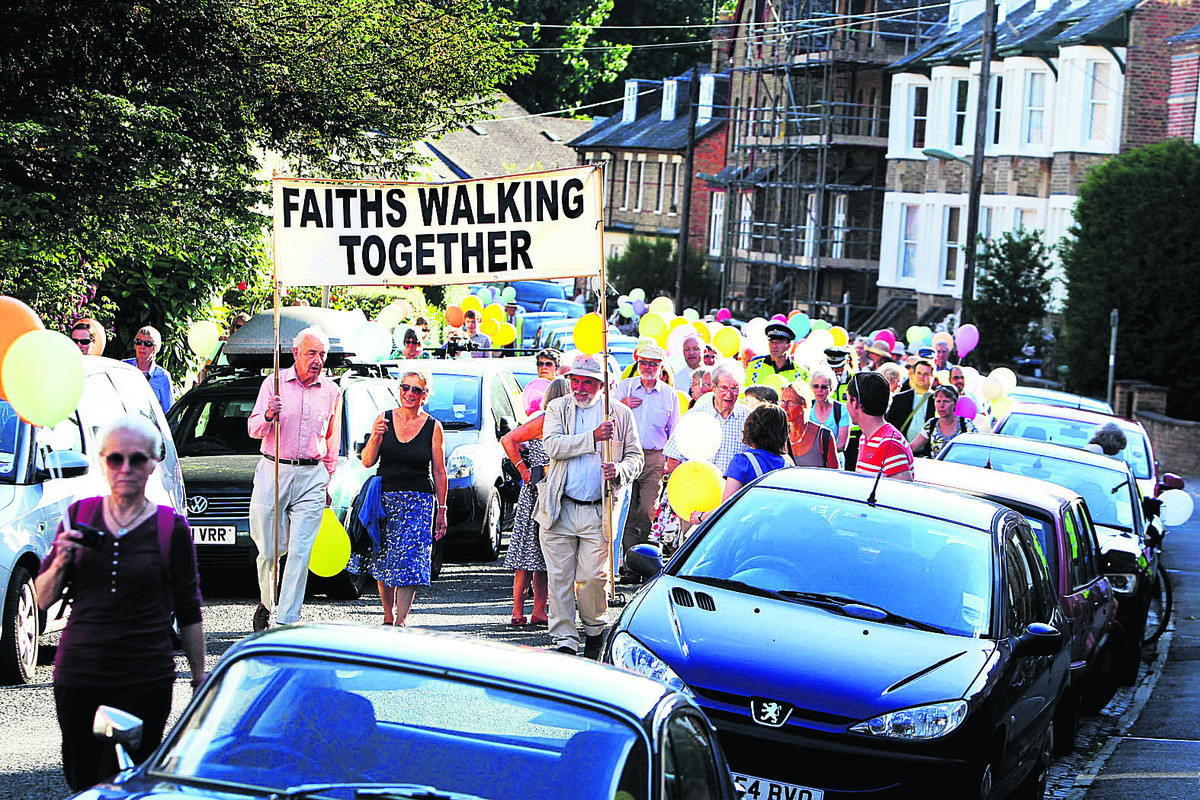 MARCH: The interfaith walk sets off from Richmond Road in Jericho