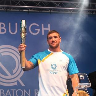 The Oxford Times: Alex Arthur carried the Glasgow 2014 Queen's Baton on to the stage as it ended the day in Edinburgh (David Cheskin for Glasgow 2014)