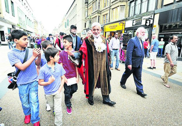 Mohammed Abbasi leads the procession down Cornmarket