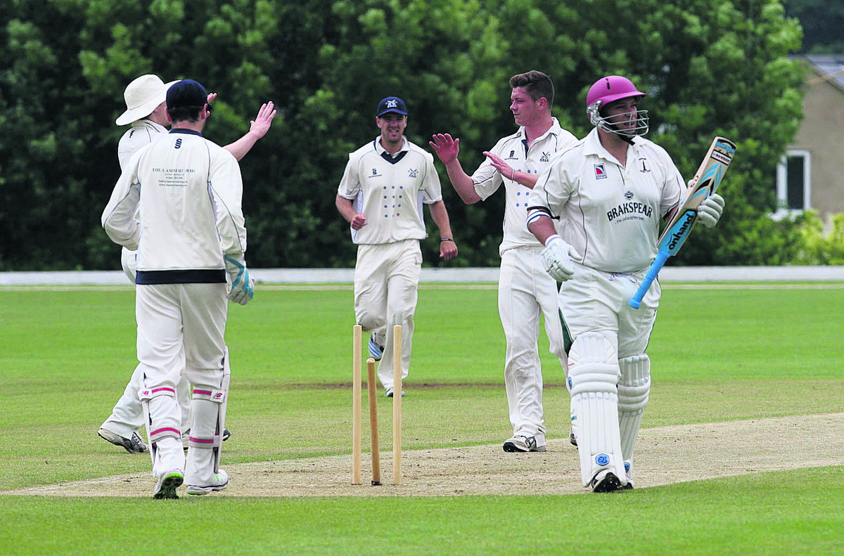 Banbury's opener Craig Haupt (above) leaves the crease as Aston Rowant bowler Karl Penhale is congratulated on his dismissa