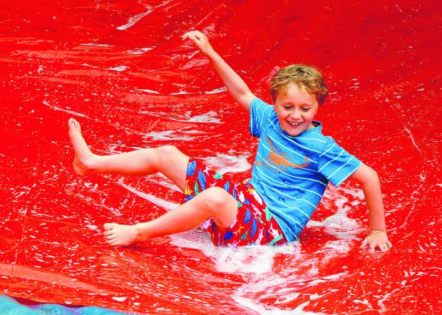 The Oxford Times: Toby Webster, nine, enjoys the water slide