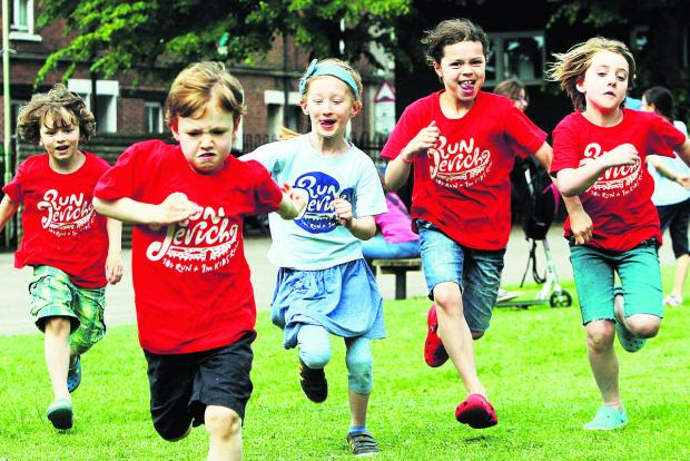 From left, six-year-olds Milo Spiller, Otto Rourke and Alex Molduano, and eight-year-olds Zinzi Spiller and Elspeth Bailey get in some practice for Run Jericho outside St Barnabas Primary School.  Picture: OX67869 Ed Nix