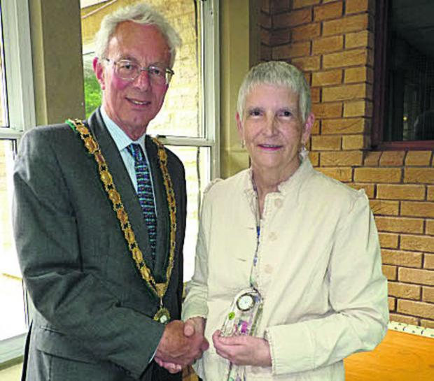 Derek Cotterill makes the presentation to Diana Ray