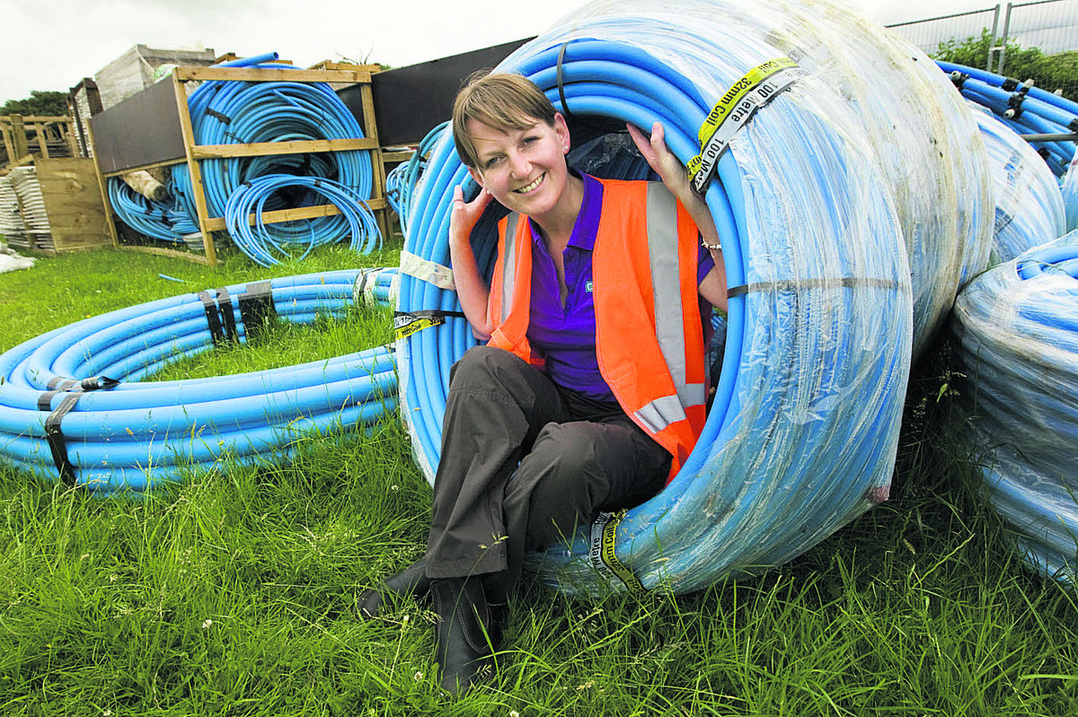 Head of operations Liz Haynes with some of the 10km of underground water piping to be installed