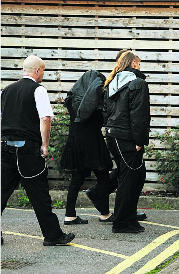 The Oxford Times: Fiaz Munshi, pictured being escorted into court