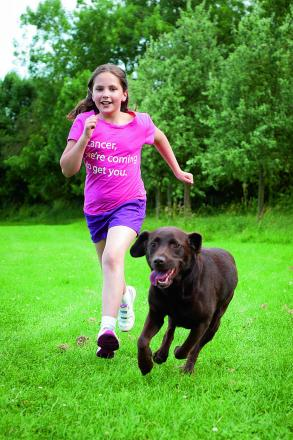 Nine-year-old Georgia Knowlden is running the race for life next month with her dog Coco because her mother Lara has cancer. Picture: OX67962 Andrew Walmsley