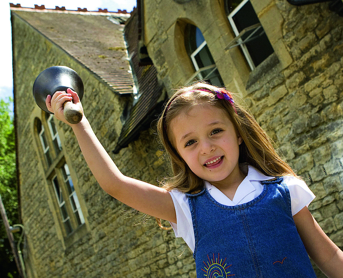 Headington Quarry school pupil Maria-Francesca Benedetto, five, rings the old school bell as the institution celebrates 150 years. Picture: OX68044 Antony Moore