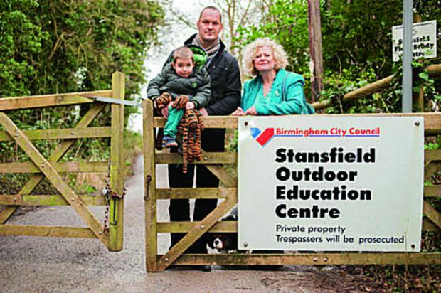 Centre, Andy Spooner, deputy head of Windmill Primary, Headington, with son Finlay and Cllr Roz Smith.