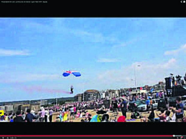 The parachutist misses the drop zone during a display, injuring a pensioner.