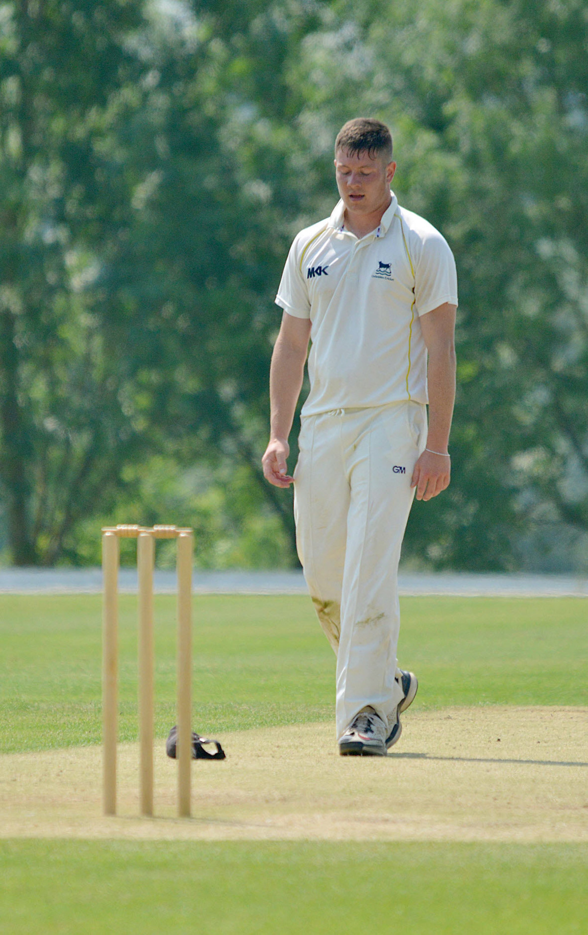 Oxon fast bowler Karl Penhale is not a happy man at the end of an over against Devon