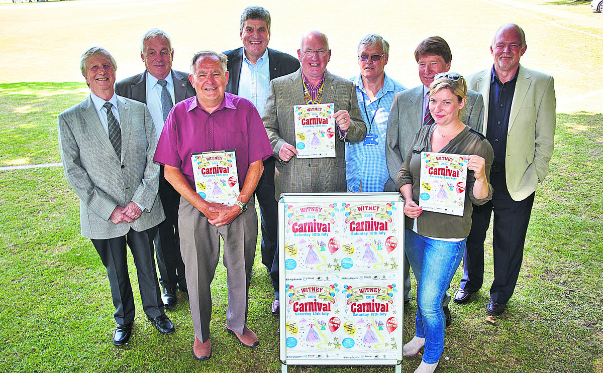 Carnival committee chairman Ron Spurs, centre, with committee members and sponsors, including Yarrow Davies, of Base 33, front, right