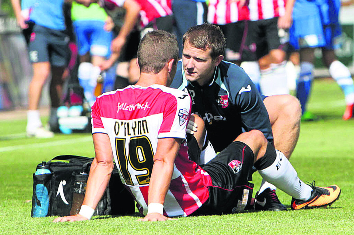 Andrew Proctor (right) in action as Exeter's physio