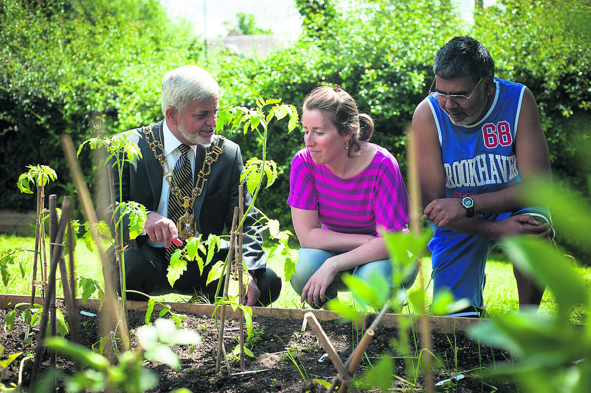 NOW OPEN: Lord Mayor Mohammed Abbasi, left, with Restore recovery worker Sally Harris and patient Eric Deen